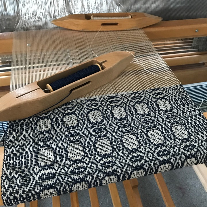 Navy and ivory on loom